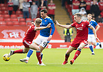 Aberdeen v St Johnstone…18.09.21  Pittodrie    SPFL<br />Michael O'Halloran is closed down by Jack MacKenzie and Lewis Ferguson<br />Picture by Graeme Hart.<br />Copyright Perthshire Picture Agency<br />Tel: 01738 623350  Mobile: 07990 594431
