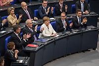 19. Sitzung des Deutschen Bundestag am Mittwoch den 14. Maerz 2018.<br /> Erster Tagesordnungspunkt war die Wahl von Angela Merkel zur Bundeskanzlerin.<br /> Im Bild: Angela Merkel ist mit 364 von 692 abgegebenen Stimmen zum vierten Mal zur Bundeskanzlerin gewaehlt worden. Die Abgeordneten der CDU/CSU-Fraktion applaudieren Angela Merkel zur erfolgreichen Wahl.<br /> 14.3.2018, Berlin<br /> Copyright: Christian-Ditsch.de<br /> [Inhaltsveraendernde Manipulation des Fotos nur nach ausdruecklicher Genehmigung des Fotografen. Vereinbarungen ueber Abtretung von Persoenlichkeitsrechten/Model Release der abgebildeten Person/Personen liegen nicht vor. NO MODEL RELEASE! Nur fuer Redaktionelle Zwecke. Don't publish without copyright Christian-Ditsch.de, Veroeffentlichung nur mit Fotografennennung, sowie gegen Honorar, MwSt. und Beleg. Konto: I N G - D i B a, IBAN DE58500105175400192269, BIC INGDDEFFXXX, Kontakt: post@christian-ditsch.de<br /> Bei der Bearbeitung der Dateiinformationen darf die Urheberkennzeichnung in den EXIF- und  IPTC-Daten nicht entfernt werden, diese sind in digitalen Medien nach §95c UrhG rechtlich geschuetzt. Der Urhebervermerk wird gemaess §13 UrhG verlangt.]