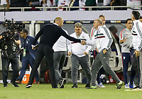 CHICAGO, ILLINOIS - JULY 07: Gregg Berhalter congratulates the Mexican coaches during the 2019 CONCACAF Gold Cup Final match between the United States and Mexico at Soldier Field on July 07, 2019 in Chicago, Illinois.