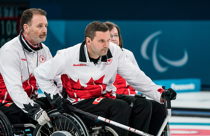 Mark Ideson and Jamie Anseeuw, PyeongChang 2018 - Wheelchair Curling // Curling en fauteuil roulant.<br /> Canada competes against Slovakia in Wheelchair curling // Le Canada affronte la Slovaquie au curling en fauteuil roulant. 14/03/2018.