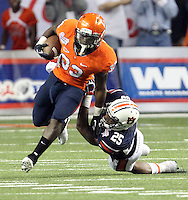 ATLANTA, GA - DECEMBER 31: Perry Jones #33 of the Virginia Cavaliers runs past Daren Bates #25 of the Auburn Tigers during the 2011 Chick Fil-A Bowl against the Auburn Tigers at the Georgia Dome on December 31, 2011 in Atlanta, Georgia. Auburn defeated Virginia 43-24. (Photo by Andrew Shurtleff/Getty Images) *** Local Caption *** Perry Jones;Daren Bates