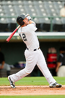 Charlotte Knights third baseman Brent Morel (12) follows through on his swing against the Syracuse Chiefs at Knights Stadium on August 29, 2012 in Fort Mill, South Carolina.  (Brian Westerholt/Four Seam Images)