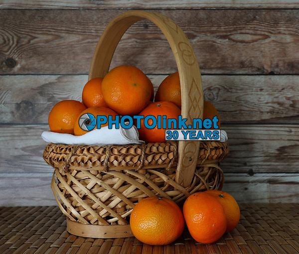 Mandarin Oranges in a Wicker Basket<br /> Photo By Adam Scull/PHOTOlink.net