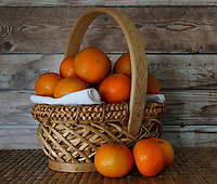 Mandarin Oranges in a Wicker Basket<br /> Photo By Adam Scull/PHOTOlink.net