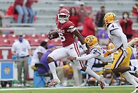 Arkansas wide receiver Treylon Burks (16) carries the ball for a score, Saturday, November 21, 2020 during the first quarter of a football game at Donald W. Reynolds Razorback Stadium in Fayetteville. Check out nwaonline.com/201122Daily/ for today's photo gallery. <br /> (NWA Democrat-Gazette/Charlie Kaijo)