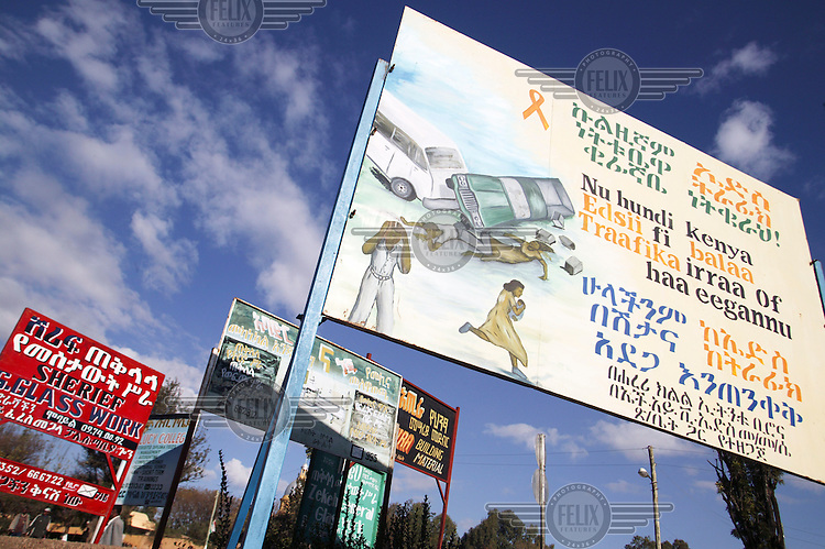 Billboard with an image of a car crash.