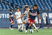 FOXBOROUGH, MA - AUGUST 7: Nicolas Firmino #29 of New England Revolution II brings the ball forward as Wilfredo Rivera #62 of Orlando City B defends during a game between Orlando City B and New England Revolution II at Gillette Stadium on August 7, 2020 in Foxborough, Massachusetts.