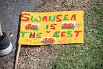 A banner made by schoolchildren as Prince Charles,  Prince of Wales and Camilla, Dutchess of Cornwall visit Victoria Park in Swansea today to help celebrate the 50th anniversary of Swanseas achieving City status.