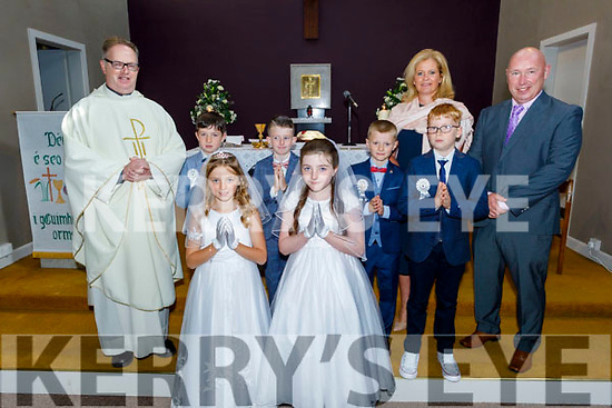 The communion class of St Brendans NS Fenit at the Oratory in Fenit on Saturday for their First Holy Communion with Fr Pat Crean Lynch, Ashling O'Sullivan (Principal) and Padraig O'Connell (Class Teacher).