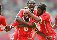 July 26, 2012..UAE's Ismaeil Matar, Ahmed Khalil and Rashed Eisa celebrate a goal. UAE vs Uruguay Football match during 2012 Olympic Games at Old Trafford in Manchester, England. Uruguay defeat United Arab Emirates 2-1...