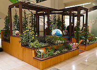 """A 3/4 view with people of Orange Coast College's Ornamental Horticulture Club's first-place winning garden installation at the 2012 South Coast Plaza Spring Garden Show in Costa Mesa, CA.  The theme for the show was """"healing gardens"""", and the OCC team installed a """"garden for the visually impaired.""""  This picture was taken Thursday April 27, 2012 at ~9pm, less than 48 hours after my in-progress pictures."""