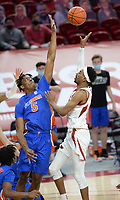 Arkansas guard Jalen Tate (right) takes a shot in the lane Tuesday, Feb. 16, 2021, as Florida forward Omar Payne (5) reaches to block during the first half of play in Bud Walton Arena. Visit nwaonline.com/210217Daily/ for today's photo gallery. <br /> (NWA Democrat-Gazette/Andy Shupe)