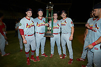 Will Guay (47), John Witkowski (43), Jake Sommers (52), and Tyler Peck (16) pose for a photo with the Appalachian League trophy following the win over the Burlington Royals at Burlington Athletic Stadium on September 4, 2019 in Burlington, North Carolina. The Cardinals defeated the Royals 8-6 to win the 2019 Appalachian League Championship. (Brian Westerholt/Four Seam Images)