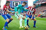 Gerard Pique Bernabeu (c) of FC Barcelona fights for the ball with Filipe Luis and Jorge Resurreccion Merodio, Koke, of Atletico de Madrid during their La Liga match between Atletico de Madrid and FC Barcelona at the Santiago Bernabeu Stadium on 26 February 2017 in Madrid, Spain. Photo by Diego Gonzalez Souto / Power Sport Images