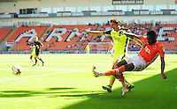 Blackpool's Bright Osayi-Samuel crosses the ball despite the attentions of Exeter City's Craig Woodman<br /> <br /> Photographer Kevin Barnes/CameraSport<br /> <br /> Football - The EFL Sky Bet League Two - Blackpool v Exeter City - Saturday 6th August 2016 - Bloomfield Road - Blackpool<br /> <br /> World Copyright © 2016 CameraSport. All rights reserved. 43 Linden Ave. Countesthorpe. Leicester. England. LE8 5PG - Tel: +44 (0) 116 277 4147 - admin@camerasport.com - www.camerasport.com