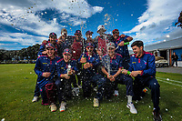 Easts players celebrate winning division two after the Hazlett Trophy Wellington cricket match between Petone-Riverside and Eastern Suburbs at Petone Recreation Ground in Petone, New Zealand on Saturday, 19 December 2020. Photo: Dave Lintott / lintottphoto.co.nz