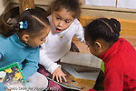 Preschool group of girls looking at books and talking with animation horizontal