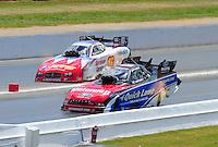 May 15, 2011; Commerce, GA, USA: NHRA funny car driver Bob Tasca III (near) races Johnny Gray during the Southern Nationals at Atlanta Dragway. Mandatory Credit: Mark J. Rebilas-