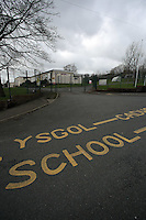 "Pictured: The bilingual ""School Keep Clear"" sign on the tarmac outside Llangennech Junior School, west Wales. Thursday 24 February 2017<br />