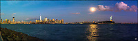 Moonrise over Hudson River, the Statue of Liberty and Manhattan skyline.