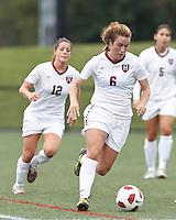 Harvard University midfielder Haley Washburn (6) brings the ball forward. In overtime, Harvard University defeated Yale University,1-0, at Soldiers Field Soccer Stadium, on September 29, 2012.