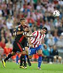 Bayer Leverkusen's Arturo Vidal against Atletico de Madrid's Raul Garcia during Europa League match. September 30, 2010. (ALTERPHOTOS/Alvaro Hernandez)