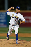 Lindsey Caughel #29 of the Rancho Cucamonga Quakes pitches against the Lake Elsinore Storm at LoanMart Field on August 6, 2013 in Rancho Cucamonga, California. Lake Elsinore defeated Rancho Cucamonga, 13-5. (Larry Goren/Four Seam Images)