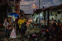 Customers walk on a busy street during a Sunday market at night, in Eterazama town, Chapare region, Bolivia. December 01, 2019.<br /> Des clients marchent dans une rue animée lors d'un marché le dimanche soir, dans la ville d'Eterazama, région du Chapare, Bolivie. 01 décembre 2019.