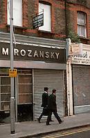 London:  Spitalfields--Brick Lane E1, Shops--M. Rozansky, trimming merchants, & Bilash Saree Centre.  18th century brick.  Photo '90.