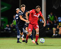 LAKE BUENA VISTA, FL - JULY 26: Nick DeLeon of Toronto FC is pressured by James Sands of New York City FC during a game between New York City FC and Toronto FC at ESPN Wide World of Sports on July 26, 2020 in Lake Buena Vista, Florida.