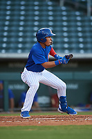 AZL Cubs 1 Fabian Pertuz (12) squares to bunt during an Arizona League game against the AZL Padres 1 on July 5, 2019 at Sloan Park in Mesa, Arizona. The AZL Cubs 1 defeated the AZL Padres 1 9-3. (Zachary Lucy/Four Seam Images)