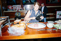 People get food before Texas senator and Republican presidential candidate Ted Cruz speaks to a crowd at aa business round-table at the Draft Sports Bar and Grille in Concord, New Hampshire. Cruz paid for the food at the event.