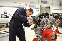 Car engine being worked on by a student, Motor Mechanics, Further Education College.