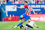 Yannick Ferreira Carrasco (l) of Atletico de Madrid is challenged by Sergio Escudero Palomo of Sevilla FC during their La Liga match between Atletico de Madrid and Sevilla FC at the Estadio Vicente Calderon on 19 March 2017 in Madrid, Spain. Photo by Diego Gonzalez Souto / Power Sport Images