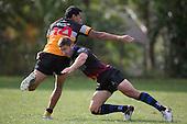 Luke Makris tackles Tasimani Sateki. Counties Manukau Premier Club rugby game between Te Kauwhata and Onewhero, played at Te Kauwhata on Saturday April 16th 2016. Onewhero won the game 37 - 0 after leading 13 - 0 at Halftime. Photo by Richard Spranger.