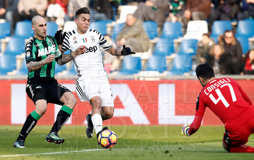 Calcio, Serie A: Sassuolo vs Juventus. Reggio Emilia, Mapei Stadium, 29 gennaio 2017. <br /> Juventus' Paulo Dybala, center, is challenged by Sassuolo's Paolo Cannavaro, left, and goalkeeper Andrea Consigli during the Italian Serie A football match between Sassuolo and Juventus at Reggio Emilia's Mapei stadium, 29 January 2017.<br /> UPDATE IMAGES PRESS/Isabella Bonotto