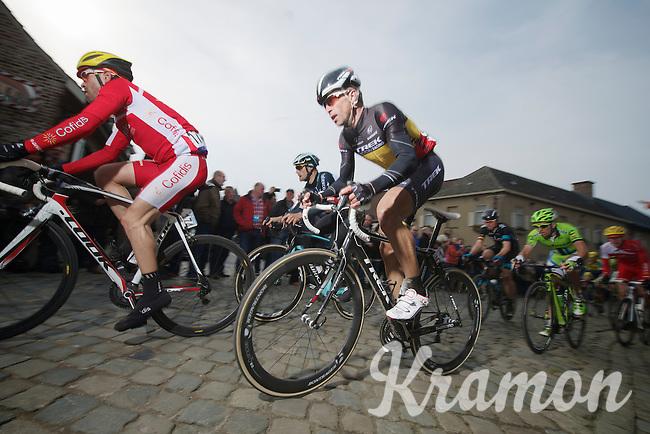 Stijn Devolder (BEL/Trek Factory Racing) over the cobbles of the Oude Kwaremont (with Tom Boonen in the background)<br /> <br /> Dwars Door Vlaanderen 2014