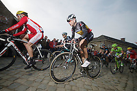 Stijn Devolder (BEL/Trek Factory Racing) over the cobbles of the Oude Kwaremont (with Tom Boonen in the background)<br /> <br /> Dwars Door Vlaanderen 2014