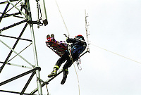 Fire service line rescue unit attending an incident where a workman has been become trapped and injured whilst working on a mobile telephone mast. They have brought with them a basket stretcher which they will strap him into and lower him down to the ground...© SHOUT. THIS PICTURE MUST ONLY BE USED TO ILLUSTRATE THE EMERGENCY SERVICES IN A POSITIVE MANNER. CONTACT JOHN CALLAN. Exact date unknown.john@shoutpictures.com.www.shoutpictures.com...