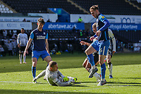 5th April 2021; Liberty Stadium, Swansea, Glamorgan, Wales; English Football League Championship Football, Swansea City versus Preston North End; Daniel Iversen of Preston North End comes out and gathers the ball while under pressure from Andre Ayew of Swansea City