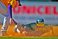 19 April 2009: University of Vermont Catamounts' outfielder Corey Moylan, a Sophomore from Glenview, IL, dives safely back to first during a game against the University at Albany Great Danes at Historic Centennial Field in Burlington, Vermont. The Great Danes defeated the Catamounts 9-4 in the second game of a double-header. Sadly, the Catamounts are playing their last season of baseball, as the program has been marked for elimination due to budgetary constraints on the University. Mandatory Photo Credit: Ed Wolfstein Photo
