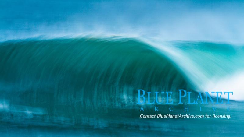 A beautiful wave goes unridden, pre-sunrise, Newport Beach.