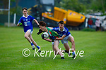 Kilcummin's Sean Doolin been well marked by Killian Spillane of  Laune Rangers in the opening round of the County MFL on Monday evening.