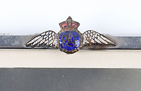 BNPS.co.uk (01202) 558833. <br /> Pic: C&TAuctions/BNPS<br /> <br /> Pictured: Flight Sergeant Eric Redfern's RAF tie pin. <br /> <br /> The poignant archive of a tragic Battle of Britain hero has been discovered in a suitcase.<br /> <br /> Flight Sergeant Eric Redfern had been married to Joan Preston for a few weeks when he was shot down and killed in 1941.<br /> <br /> The 27 year old Hurricane pilot was ambushed by German fighters during a raid on enemy supply vessels at Le Touquet in northern France.