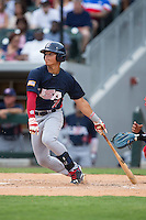 Bryson Brigman (7) of the US Collegiate National Team follows through on his swing against the Cuban National Team at BB&T BallPark on July 4, 2015 in Charlotte, North Carolina.  The United State Collegiate National Team defeated the Cuban National Team 11-1.  (Brian Westerholt/Four Seam Images)