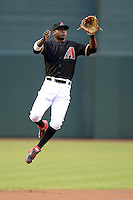Arizona Diamondbacks shortstop Didi Gregorius (1) jumps to catch a line drive during a game against the Washington Nationals at Chase Field on September 28, 2013 in Phoenix, Arizona.  Washington defeated Arizona 2-0.  (Mike Janes/Four Seam Images)