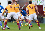 Motherwell v St Johnstone…28.11.20   Fir Park      BetFred Cup<br />Stevie May is surrounded by Ricki Lamie, Mark O'Hara and Declan Gallagher<br />Picture by Graeme Hart.<br />Copyright Perthshire Picture Agency<br />Tel: 01738 623350  Mobile: 07990 594431