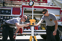 Firefighter and driver Stephen Magner (from left) and firefighter Hayden Johnson inspect a scene light, Friday, April 30, 2021 at the Lowell Fire Department in Lowell. Lowell will hold a special election May 10 for voters to extend a current 1 cent sales tax which funds about 70 percent of the city's operating budget. A bulk of the money goes to the fire department, police department and roads. Check out nwaonline.com/210501Daily/ for today's photo gallery. <br /> (NWA Democrat-Gazette/Charlie Kaijo)