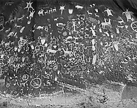 """""""Newspaper Rock"""" <br /> Newspaper Rock State Historic Monument, Utah <br /> <br /> Like a newspaper, many stories are told by people who created the petroglyphs on Newspaper Rock during the last 2,000 years. Designated a Utah Historic Monument and listed on the  National Register of Historic Places, Newspaper Rock is located about 50 miles south of Moab, Utah.  <br /> A 2 minute walk from the parking lot takes visitors within a few feet of the 650 petroglyphs."""