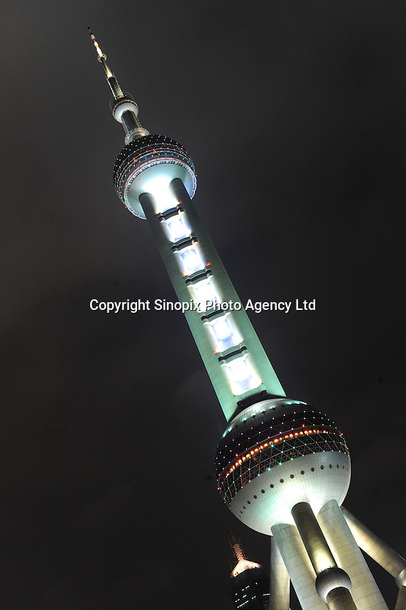 The Oriental Pearl Tower, is a TV tower in Shanghai, China. Construction began in 1990 and the tower was completed in 1994. At 468 meters(1,535 feet) high, features 11 spheres, big and small. It was the tallest structure in China from 1994-2007, when it was surpassed by the Shanghai World Financial Center. The Oriental Pearl Tower belongs to the World Federation of Great Towers..